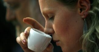 woman smelling coffee